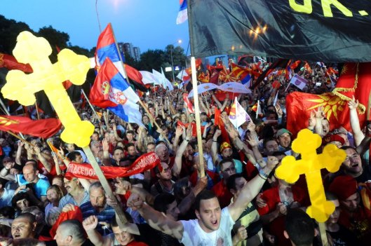 Pro-government demonstrators participate in a rally in the centre of Skopje on May 18, 2015.  Some 30,000 supporters of conservative Macedonian Prime Minister Nikola Gruevski gathered in downtown Skopje, a day after thousands of opposition demonstrators marched through the capital demanding that the premier resign.  AFP  PHOTO / ROBERT ATANASOVSKI